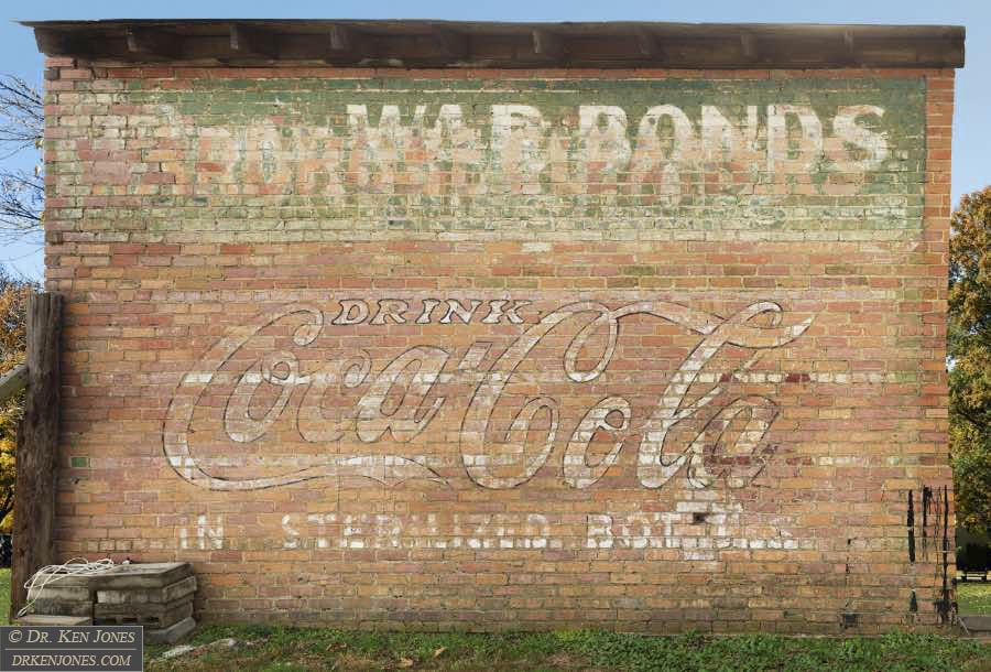 Coca Cola / War Bonds and Stamps / Barber Shop / Wardrobe Cleaners, Bald Knob, Arkansas